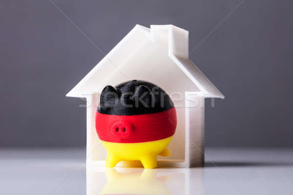 Close-up Of Piggybank With German Flag And House Model Stock photo © AndreyPopov