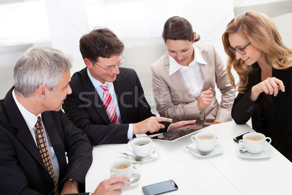 Business colleagues enjoying a coffee break Stock photo © AndreyPopov