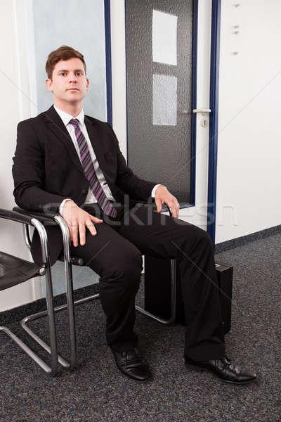 Anxieux homme séance président attente entretien d'embauche Photo stock © AndreyPopov