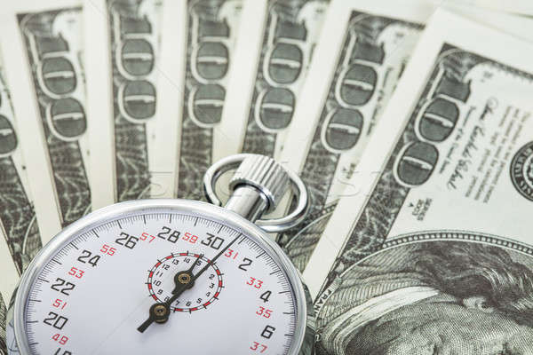 Tijd is geld stopwatch dollar succes witte cash Stockfoto © AndreyPopov