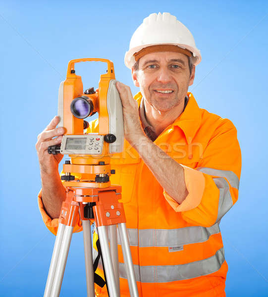 Senior land surveyor with theodolite Stock photo © AndreyPopov