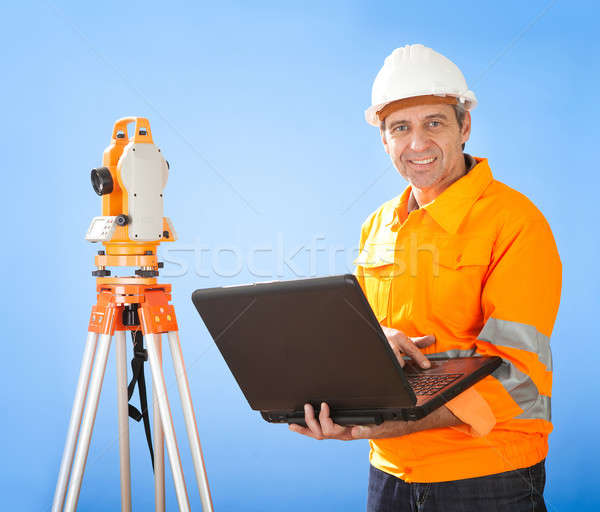 Senior land surveyor with theodelite Stock photo © AndreyPopov