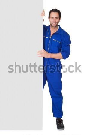 Portrait of automechanic holding empty banner Stock photo © AndreyPopov
