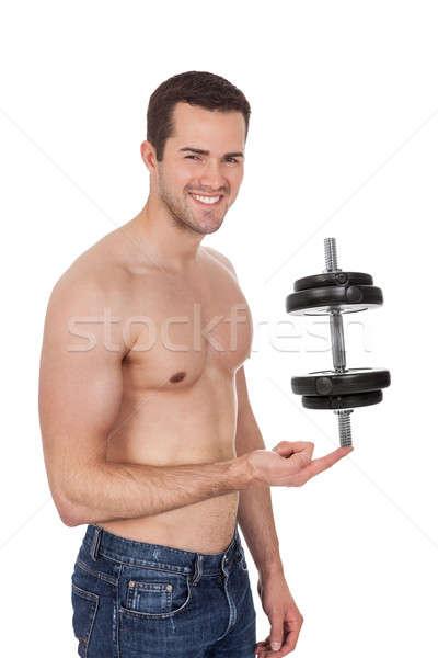 Jungen Bodybuilder männlich halten Hantel isoliert Stock foto © AndreyPopov