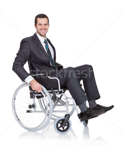 Young businessman in wheelchair Stock photo © AndreyPopov