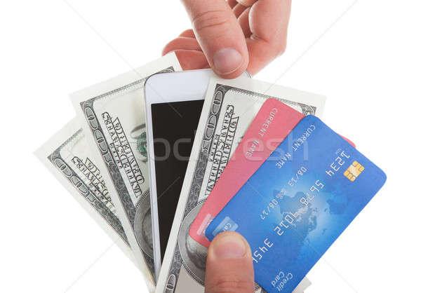 Kéz tart bankjegyek hitelkártyák tabletta második Stock fotó © AndreyPopov