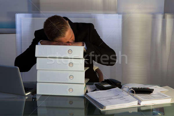 Exhausted businessman sleeping an a stack of files Stock photo © AndreyPopov