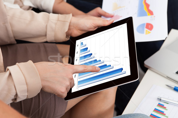 Businesswoman Touching Digital Tablet Stock photo © AndreyPopov