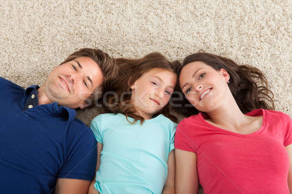 Portrait Of Family Lying On Rug Stock photo © AndreyPopov