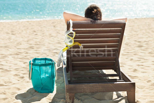 Woman with scuba mask relaxing on deck chair at beach resort Stock photo © AndreyPopov