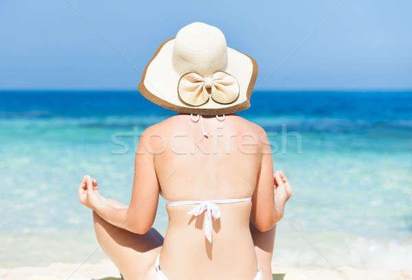 Mujer bikini meditando toalla de playa playa Foto stock © AndreyPopov