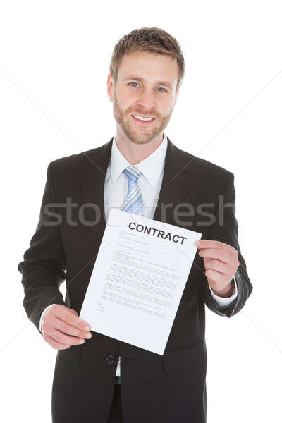 Confident Businessman Holding Contract Paper Stock photo © AndreyPopov