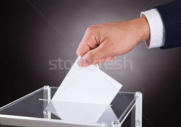 Businessman Inserting Ballot In Box On Desk Stock photo © AndreyPopov