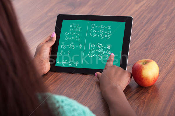 Student Solving Math Problems On Digital Tablet Stock photo © AndreyPopov
