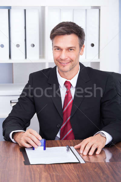 Smiling Mature Businessman Stock photo © AndreyPopov
