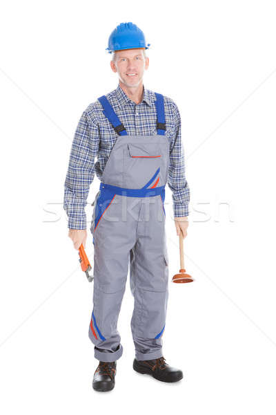 Male Worker Holding Plunger And Wrench Stock photo © AndreyPopov