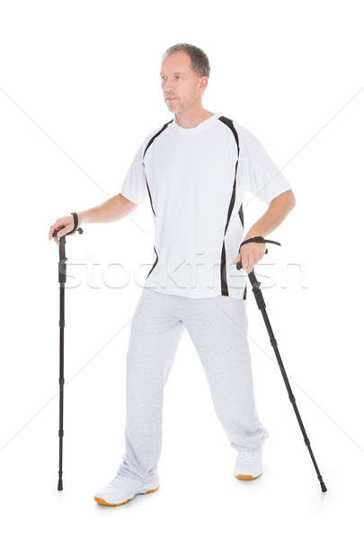 Man Walking With Hiking Pole Stock photo © AndreyPopov