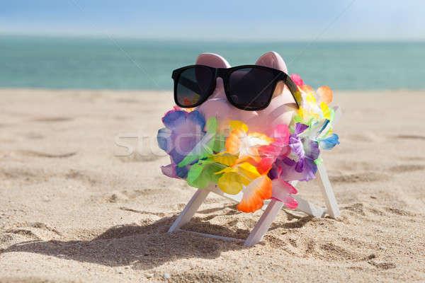 Piggy Bank Солнцезащитные очки гирлянда черный пляж небе Сток-фото © AndreyPopov
