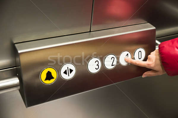 Hand Pressing First Floor In Elevator Stock photo © AndreyPopov