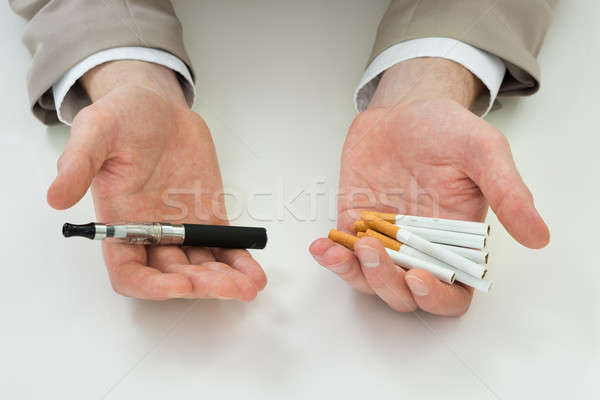 Businessperson Hand With Electronic Cigarette Stock photo © AndreyPopov