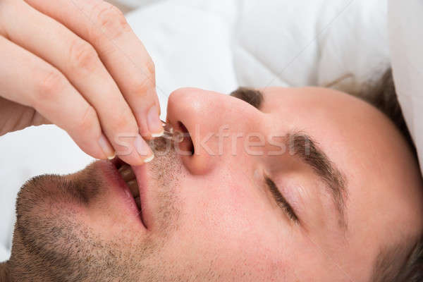 Person Hand Inserting Nose Clip Device Into Nose Stock photo © AndreyPopov