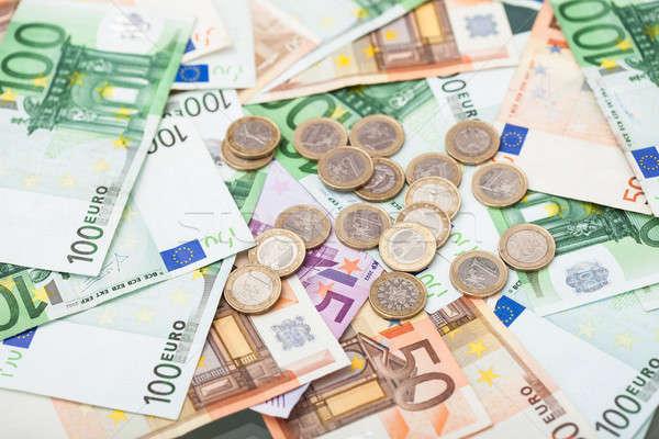 Bankjegyek érmék fotó Euro bőség papír Stock fotó © AndreyPopov