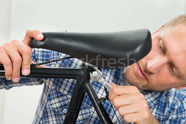 Man Tightening The Bolts Of Bicycle Seat Stock photo © AndreyPopov