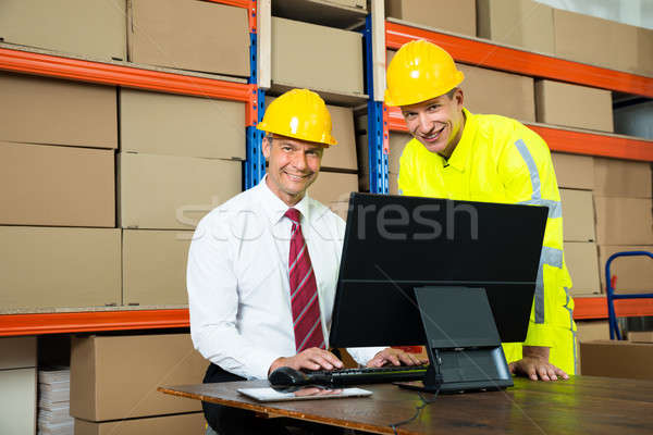 Happy Warehouse Worker And Manager Using Computer Stock photo © AndreyPopov