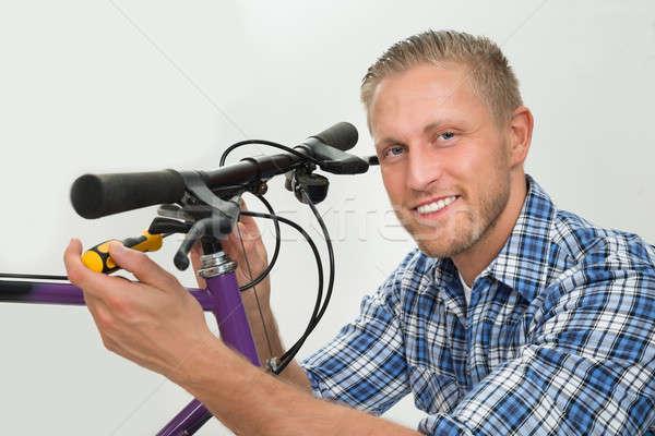Hombre bicicleta retrato feliz joven Foto stock © AndreyPopov