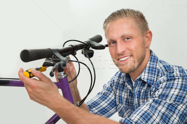 Man Repairing Bicycle Handlebar Stock photo © AndreyPopov