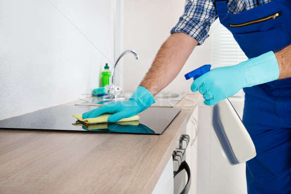 Worker Cleaning Electric Hob Stock photo © AndreyPopov