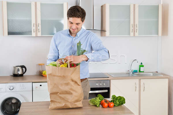 Man With Grocery Bag In Kitchen Room Stock photo © AndreyPopov