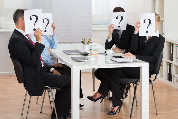 Businesspeople Hiding Faces Behind Question Mark Sign Stock photo © AndreyPopov