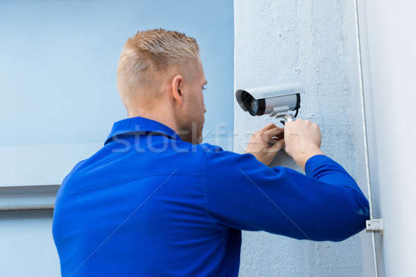 Technician Installing Camera In Corner Stock photo © AndreyPopov