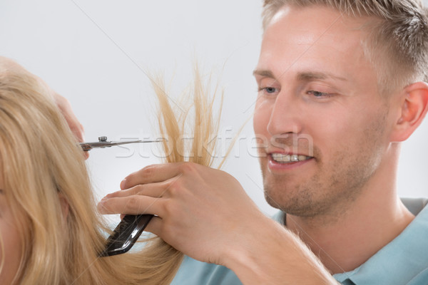 Hairdresser Cutting Customer's Hair At Salon Stock photo © AndreyPopov
