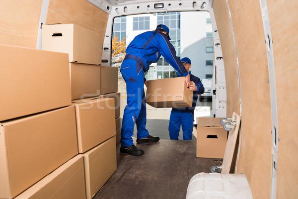 Delivery Men Loading Cardboard Boxes Stock photo © AndreyPopov