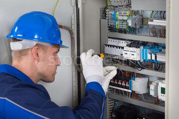 Male Technician Checking Fusebox Stock photo © AndreyPopov