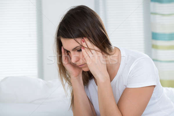 Stock photo: Portrait Of A Woman Suffering From Headache
