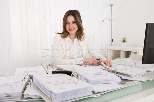 Businesswoman Calculating Tax Stock photo © AndreyPopov