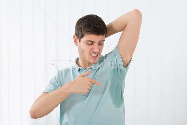 男 ポインティング 汗 脇の下 若い男 ホーム ストックフォト © AndreyPopov
