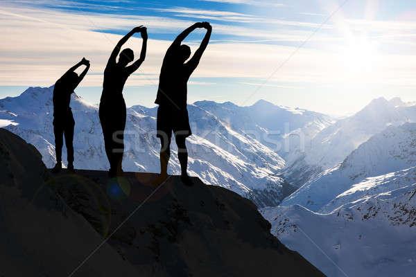シルエット 家族 ストレッチング 崖 男 スポーツ ストックフォト © AndreyPopov