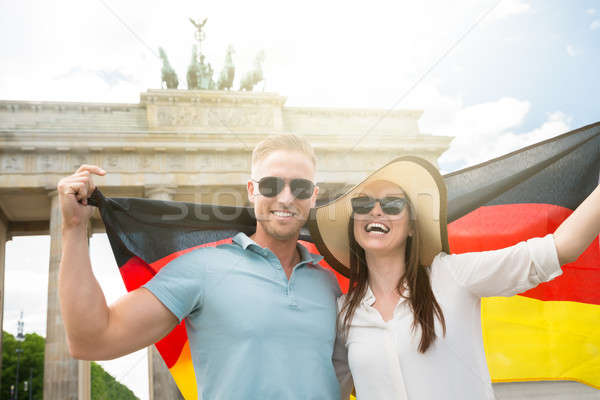 Stock photo: Smiling Couple Holding German Flag