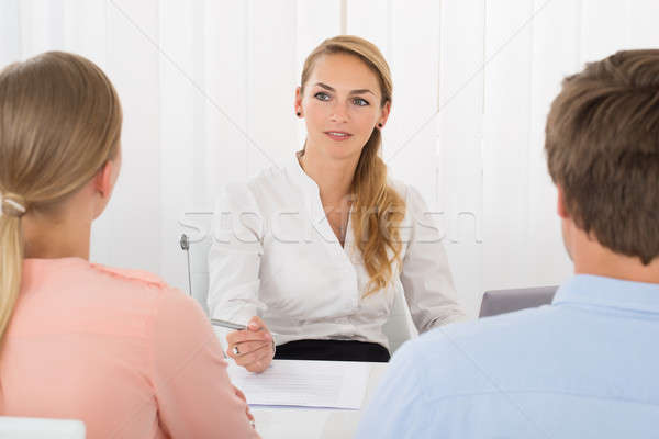 Consultant Showing Document To Couple Stock photo © AndreyPopov