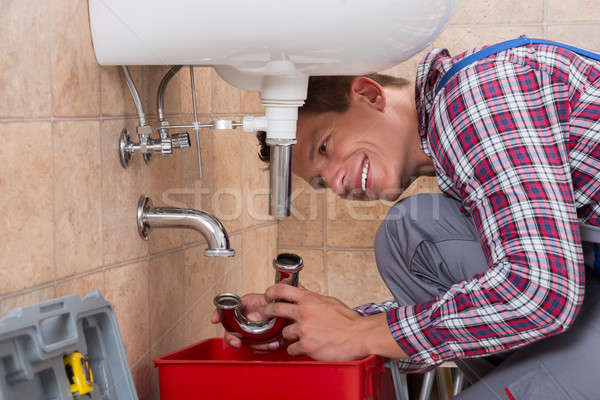Plumber Installing Sink Pipe In Bathroom Stock photo © AndreyPopov