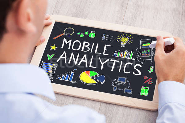 Businessperson Drawing Mobile Analytic Concept On Slate Stock photo © AndreyPopov
