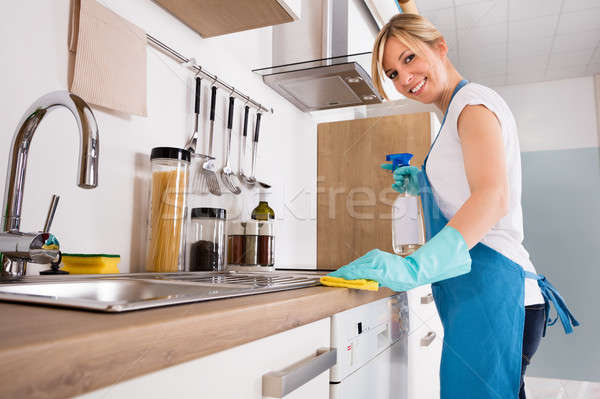 Smiling Woman Cleaning Kitchen Worktop Stock photo © AndreyPopov