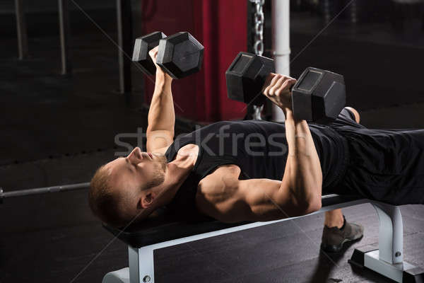 Man Exercising With Dumbbell Stock photo © AndreyPopov