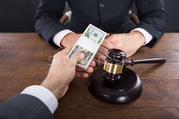 Businessman Giving A Bribe To A Judge Stock photo © AndreyPopov