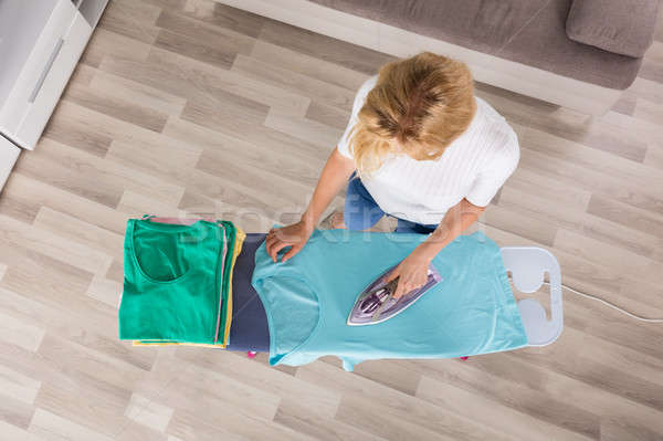 High Angle View Of Woman Ironing Clothes Stock photo © AndreyPopov