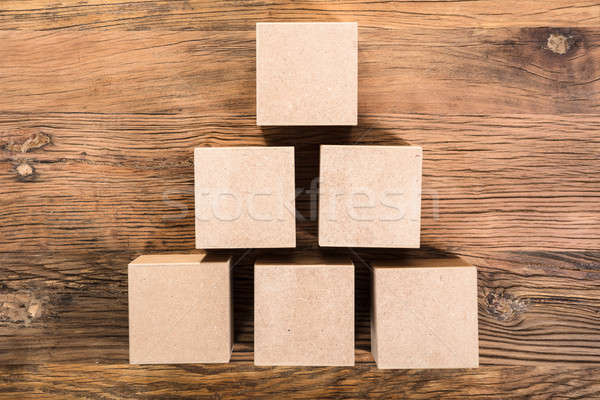 Wooden Cube Arranged In Pyramid Shape Stock photo © AndreyPopov